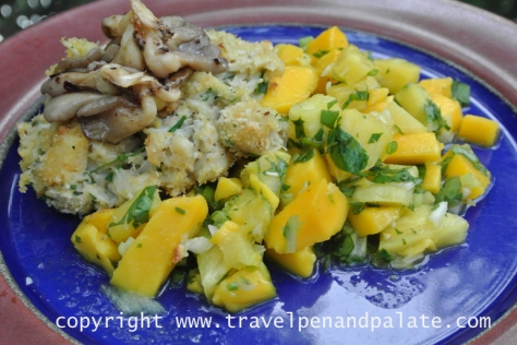 grilled crab cake with oyster mushrooms and mango pineapple salsa