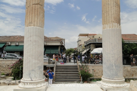 Ruins of the ancient Roman Agora looking out onto markets in modern Athens