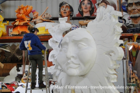carving the styrofoam base of a prop at Mardi Gras World, New Orleans