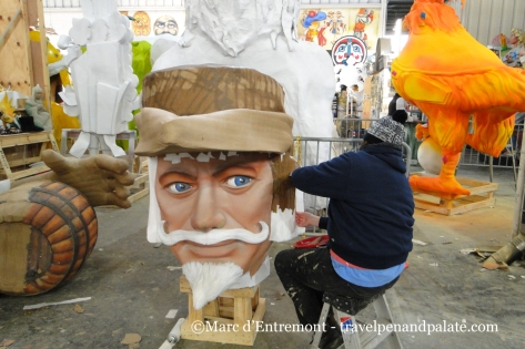adding paper mache to a prop before painting at Mardi Gras World, New Orleans