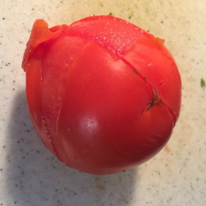 skin easily peels away from blanched tomato
