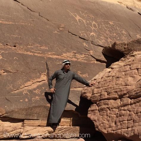 Travel guide Mohammad Qamhiya explaining pictographs in Wadi Rum, Jordan