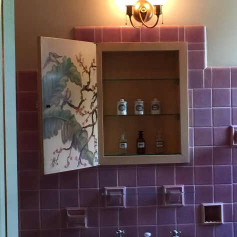 interior of every bathroom cabinet was painted with original art