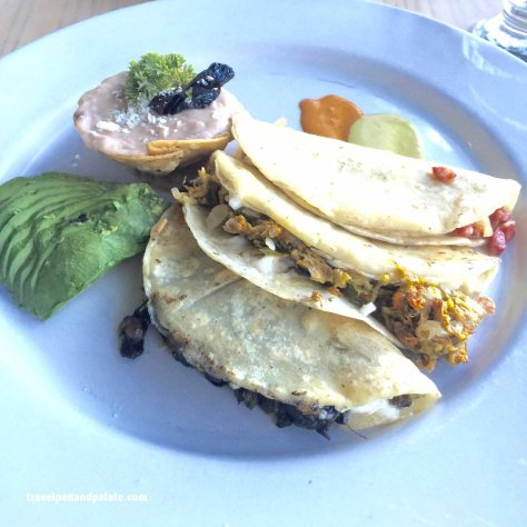 Trio of breakfast quesadillas: Huitlachoche (mushrooms that grow on local corn) Squash blossom & Mexican sausage