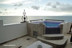 private hot tub/pool on balcony of a corner suite