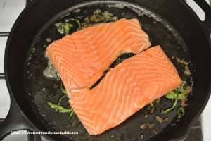 wild salmon fillets over fresh tarragon