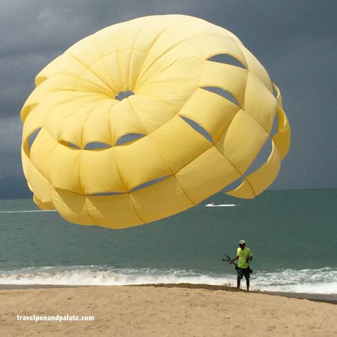 Parasailing on the beach in front of Villa Premiere