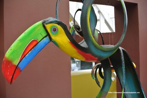 toucan crafted from a single recycled automobile tire with carved wood beak